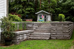 Large Retaining Wall With Natural Stone Staircase